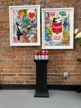 Original art and spray can sculptures by Mr. Brainwash, French street artist Thierry Guetta