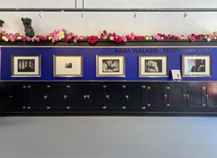 Testimony series, set of five photogravures by Kara Walker, hung above the newly restored 1940's ice cream cabinets
