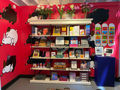 The Foundation gift shop behind the staircase, with Jules Muck's fornicating bunnies and Keith Haring skateboards
