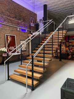 New monorail staircase leading to the Mezzanine Gallery / Conference Room - quite the labor of love installing this behemoth