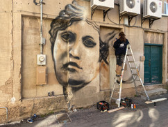Jules Muck painting Sloane's Roman Women mural on the back of the Foundation building (yes, we got DRB approval...)