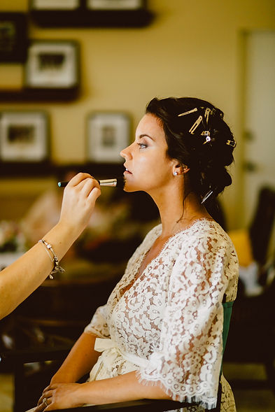 Bride getting her hair and makeup done by Leilani Artistry Studio, a Coral Springs Hair Salon