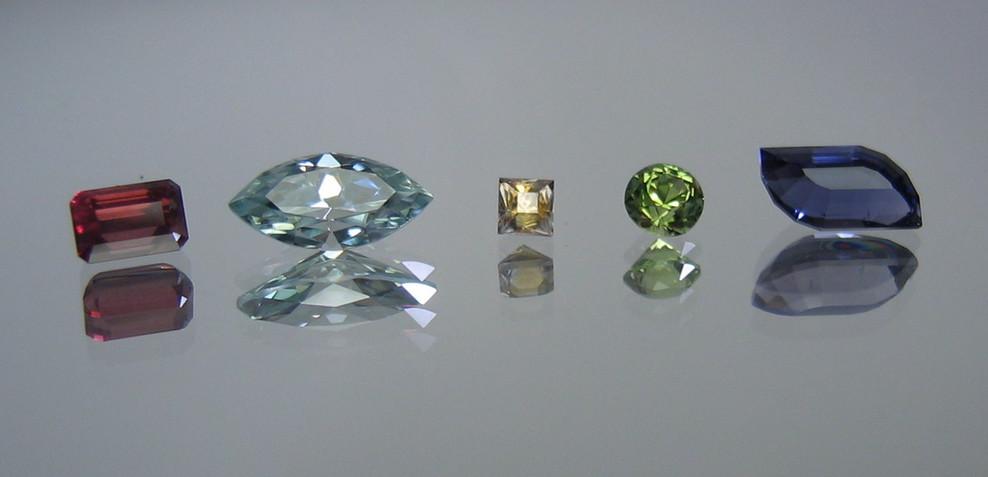 Rhodolite Garnet   Zircon   Montana Sapphire   Peridot   Iolite