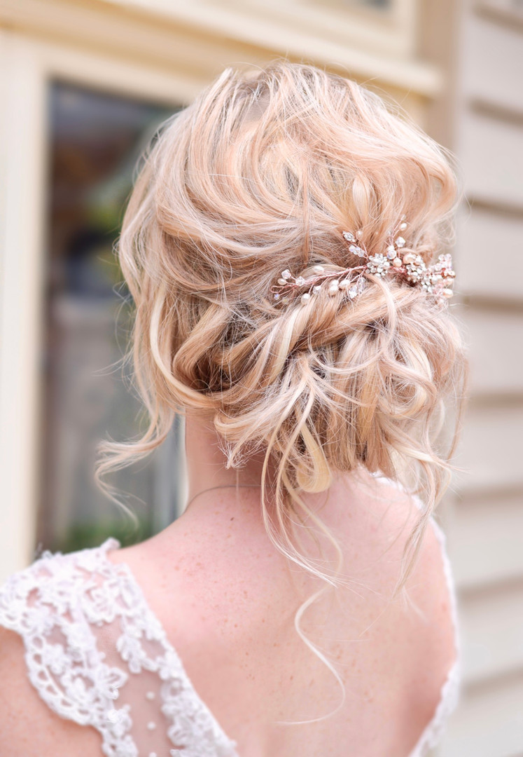 Curly textured boho updo