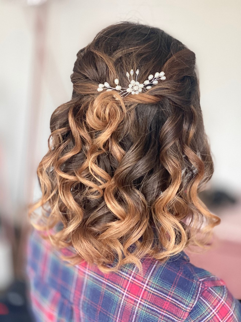 curly halfup half down hairstyle