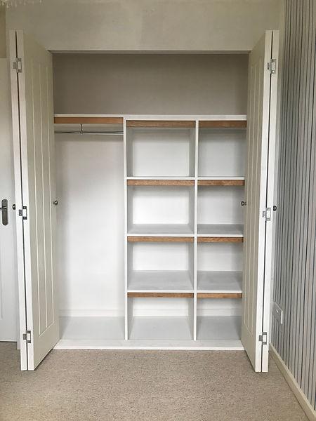 Built-in wardrobe with bi fold doors