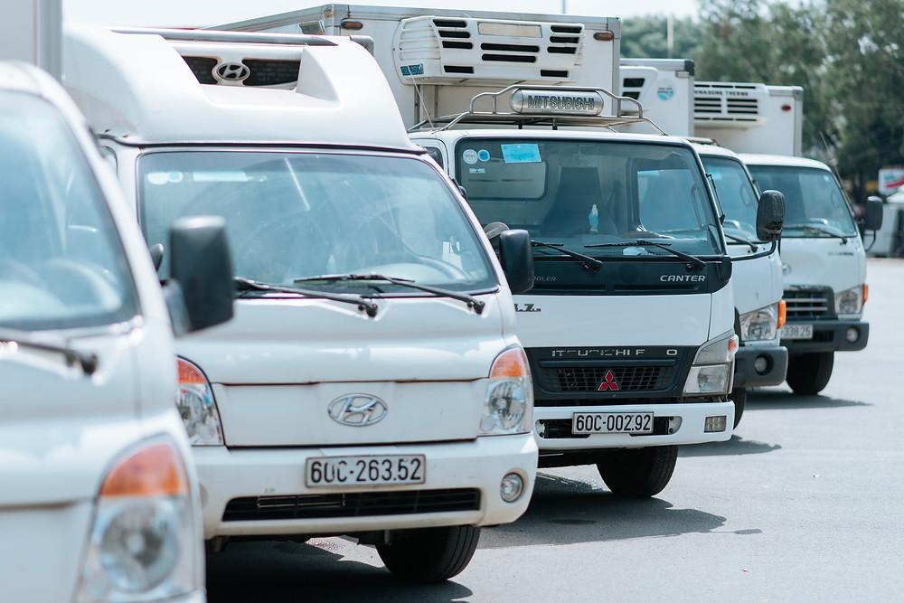 A fleet of trucks from Quoc Huan Food