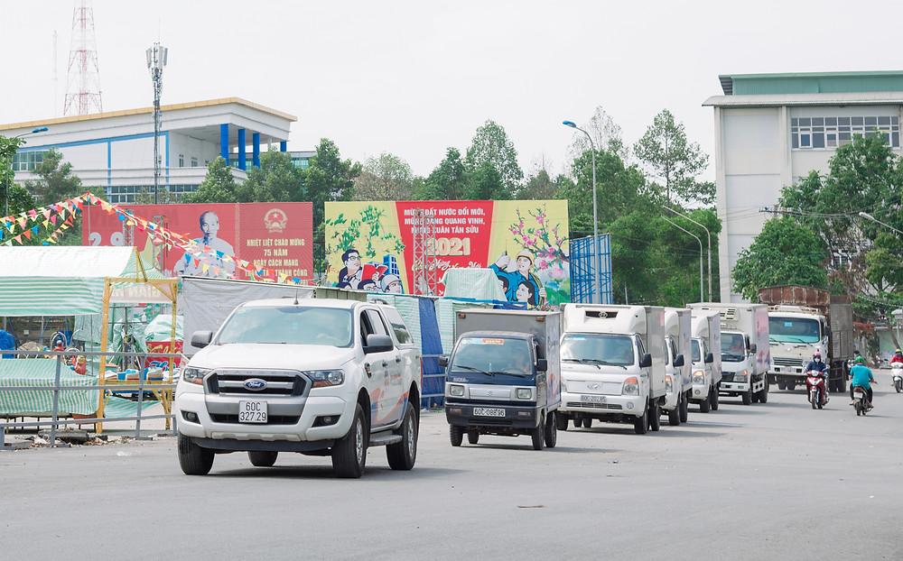 A fleet of driving trucks from Quoc Huan Food