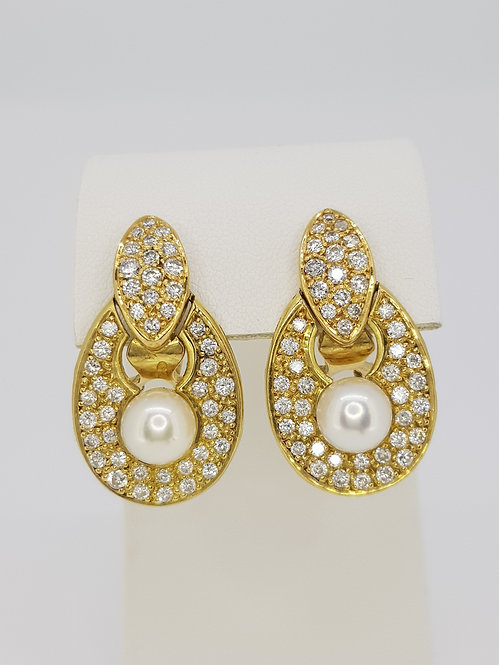 French pearl and diamond earrings.