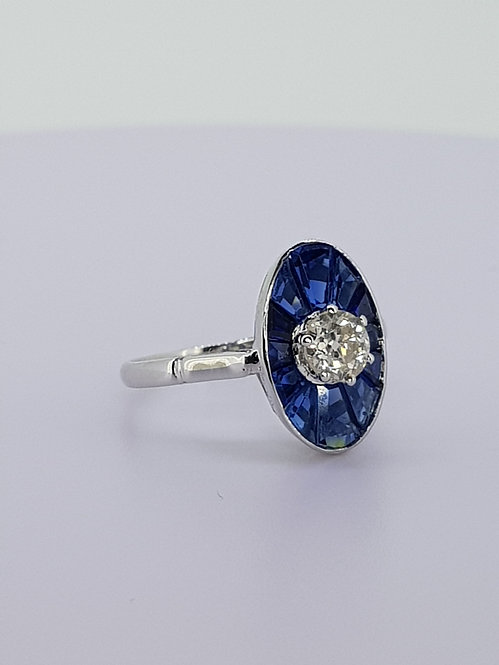 Caibre set sapphire and diamond ring.