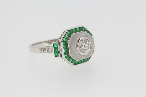 Pave set emerald and diamond ring d.60cts