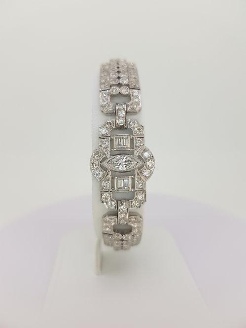 Platinum multi shaped diamonds bracelet