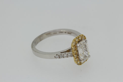 Emerald cut and yellow diamond ring.