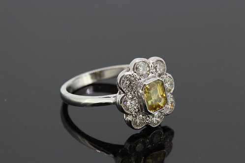 Yellow sapphire and diamond cluster ring.