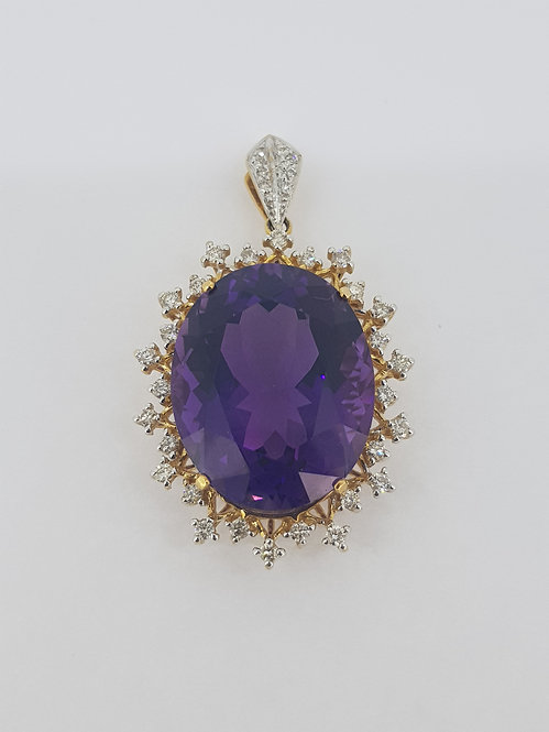 Amethyst and diamond pendant.