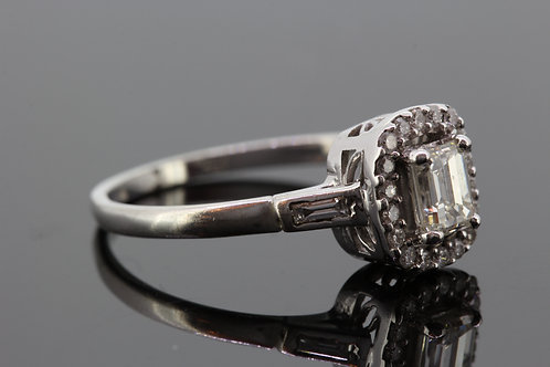 Emerald cut diamond halo ring.