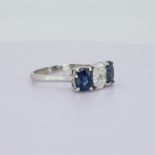 Three stone sapphire and diamond ring.