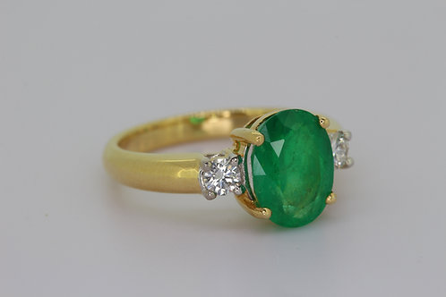 Emerald and diamond three stone