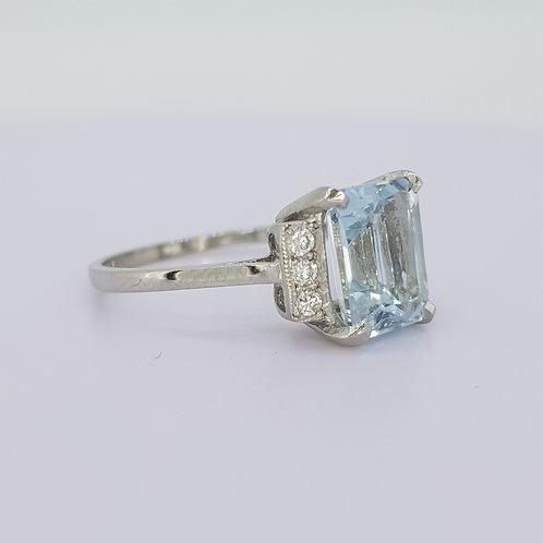 Platinum aquamarine and diamond ring.