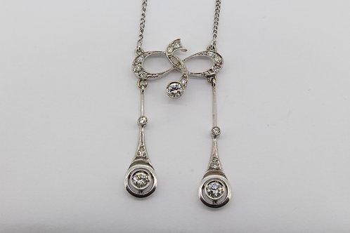 Edwardian diamond pendant and chain.
