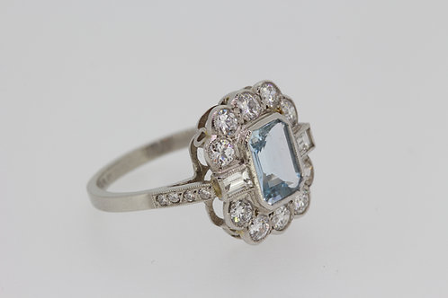 Aquamarine and diamond cluster ring a1.10cts d1.cts