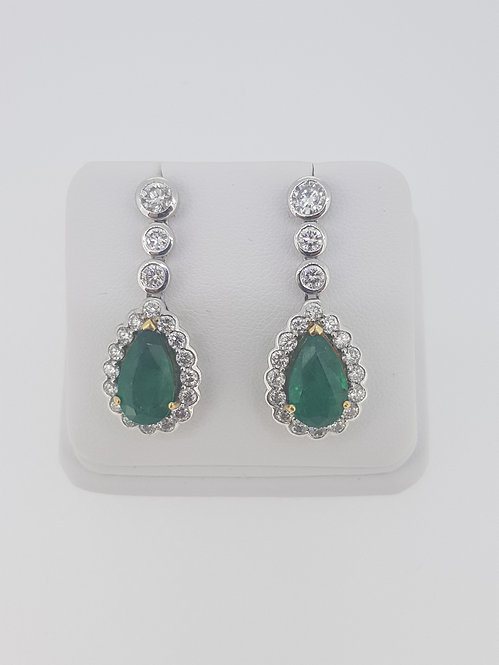 Emerald and diamond drop cluster earrings.