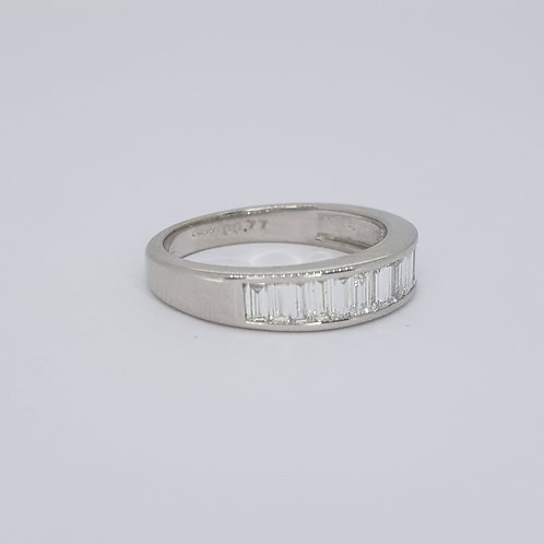Channel set baguette 1/2 eternity ring. D0.77cts