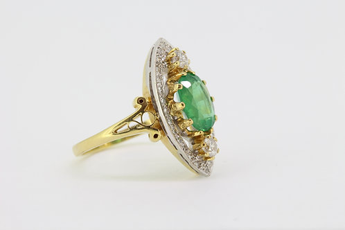 Emerald and diamond marquee ring.