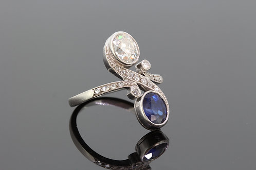 Art nouveau sapphire and diamond cross over ring
