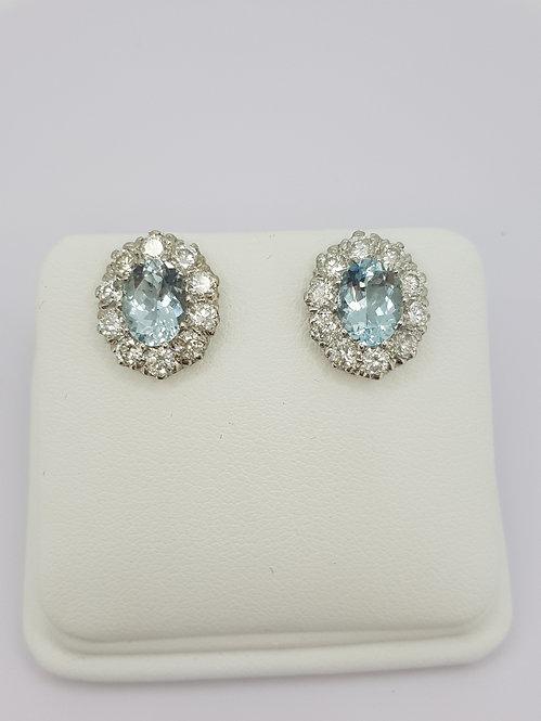 Aquamarine and diamond stud earrings.