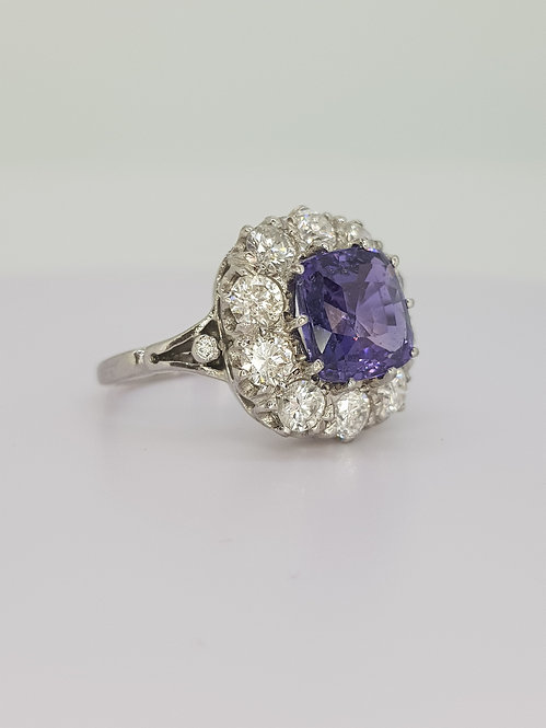 Natural sapphire and diamond cluster ring.
