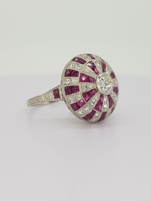 Ruby and diamond platinum ring.