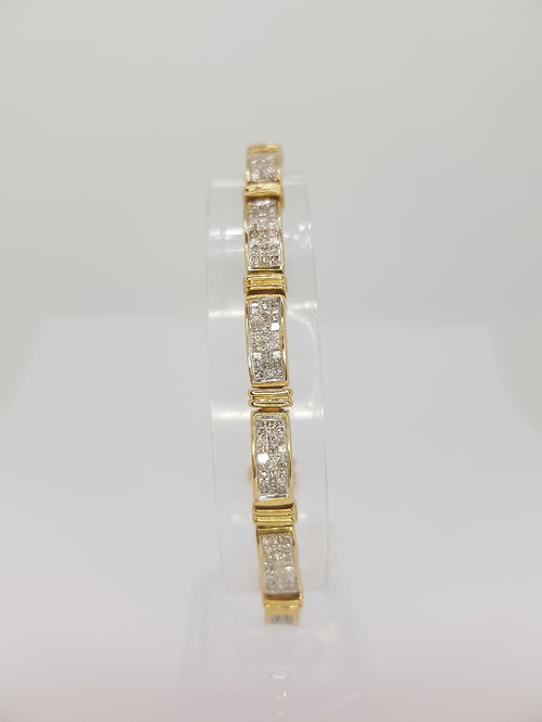 Panel bracelet set with princess cut diamonds.