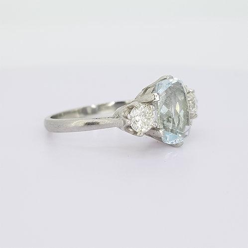 Aquamarine and diamond three stone platinum ring.