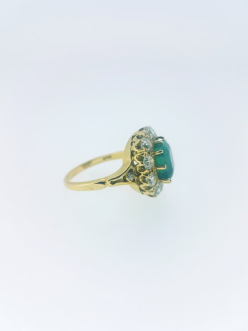 Emerald and diamond cluster ring Emerald 3.65 diamond 1.85