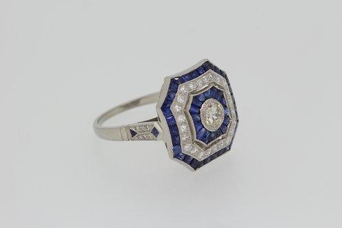 Platinum Sapphire and diamond calibre set ring
