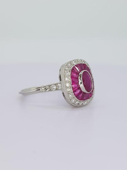 Calibre ruby and diamond ring.