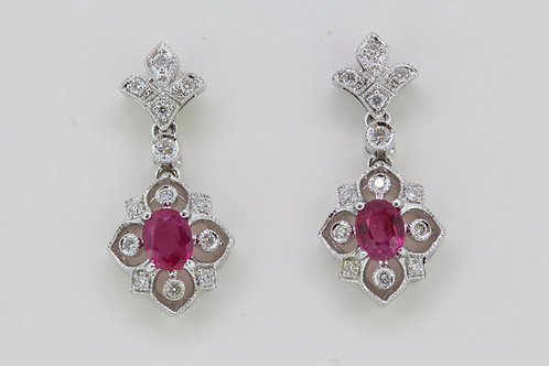 Ruby and diamond drop earrings .