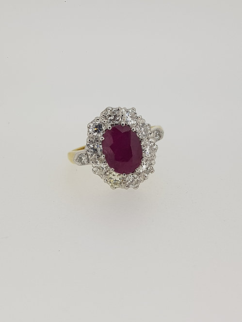 Ruby and diamond crown cluster ring.
