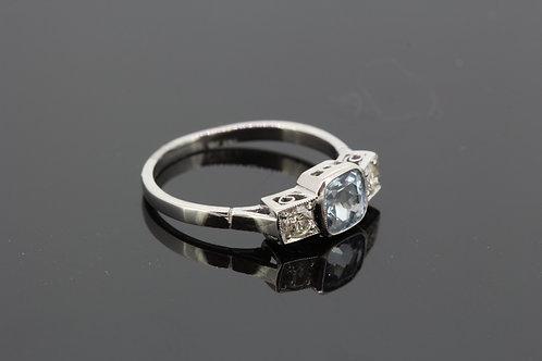 Aquamarine and diamond three stone ring.