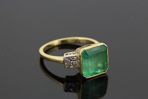 Emerald and diamond three stone