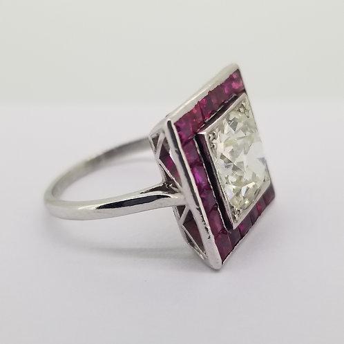 Ruby and diamond calibre set ring