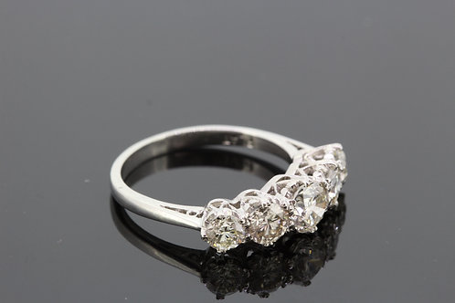 Platinum five stone diamond ring.