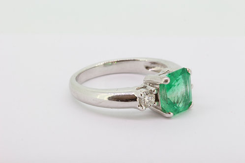 Emerald and diamond 3 stone ring.