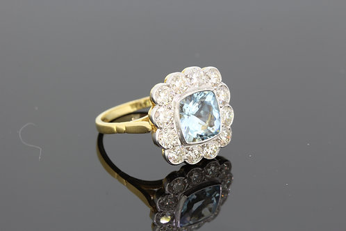 Aquamarine and diamond cluster ring a1.35cts d1.25cts