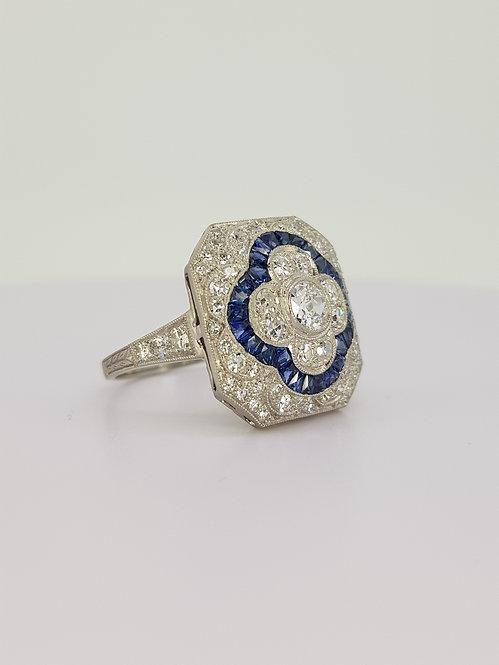 Sapphire and diamond cluster diamond ring