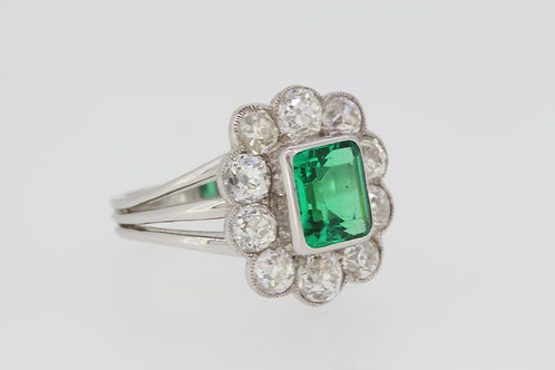 Columbian and diamond cluster ring.