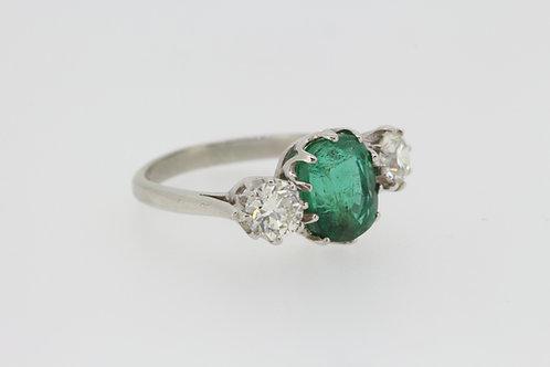 Classic emerald and diamond platinum 3 stone.