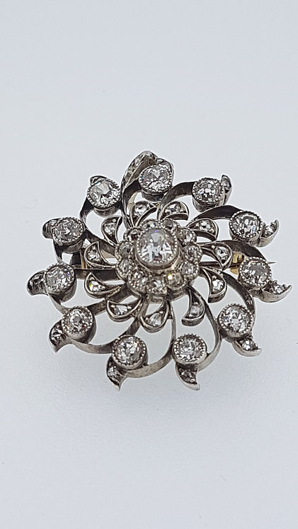 Victorian silver set gold backed diamond brooch pendant.