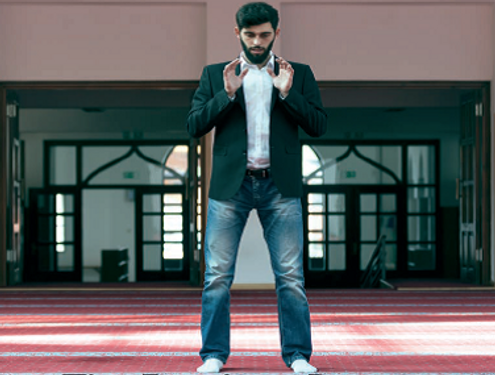 Man standing in Mosque.png